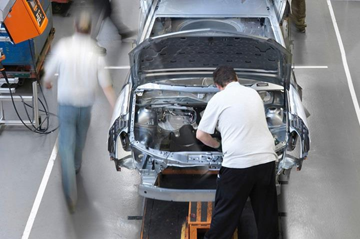 view of people working in car assembly line plant